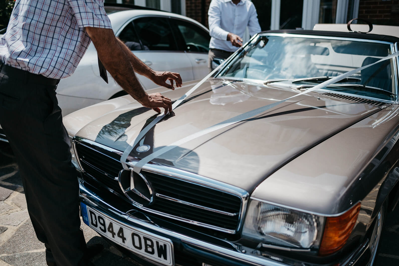 vintage mercedes convertible with wedding ribbon for stylish London Wedding