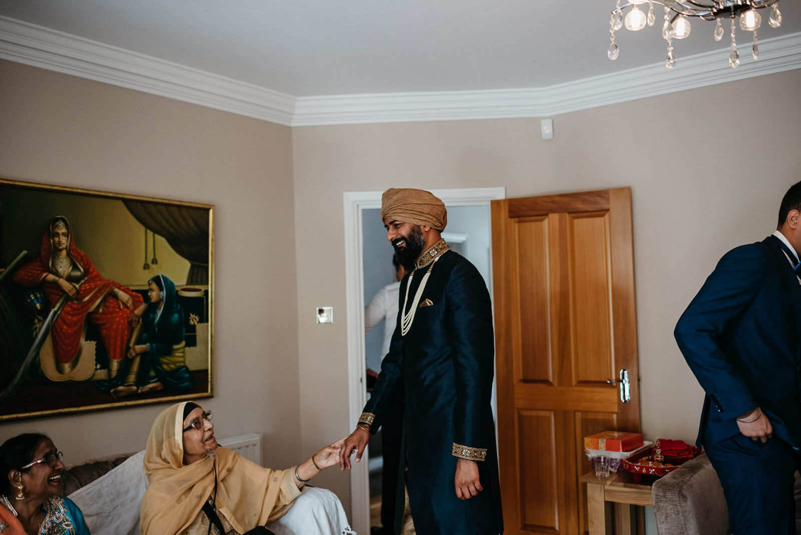 groom is greeted by family in his home before his London wedding at Marylebone One