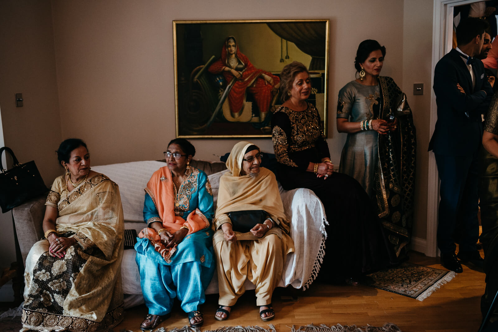 London grooms family in traditional indian dress await his arrival