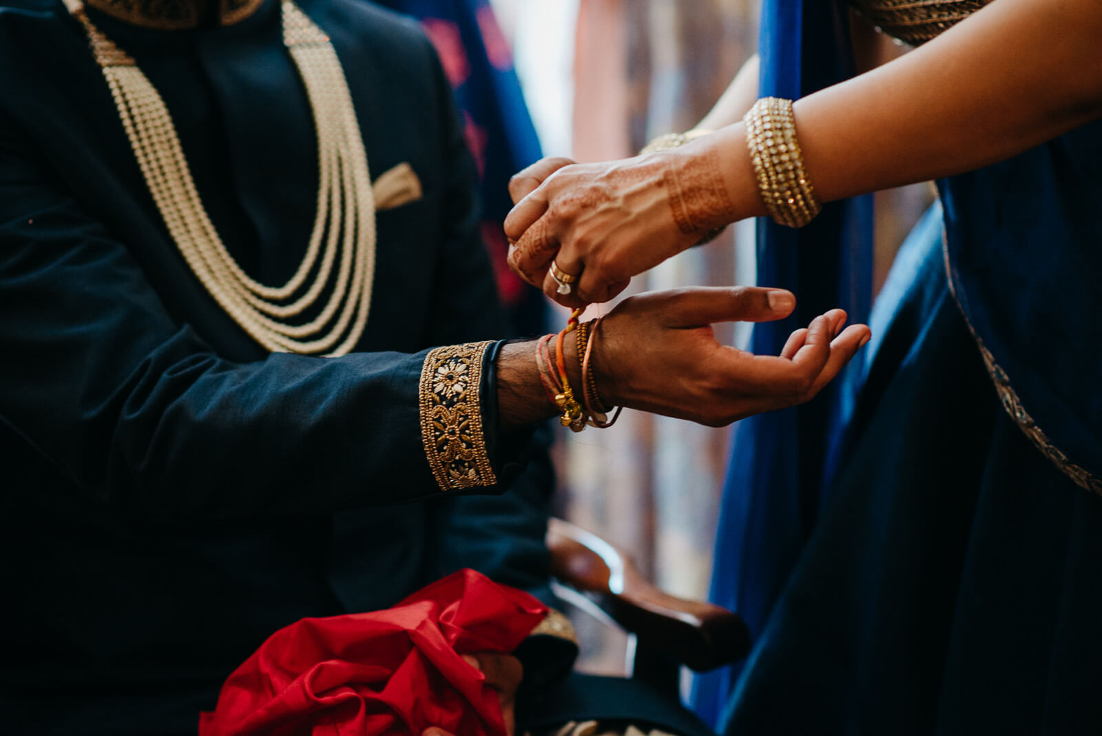 Hindu groom has bracelets placed on his wrist