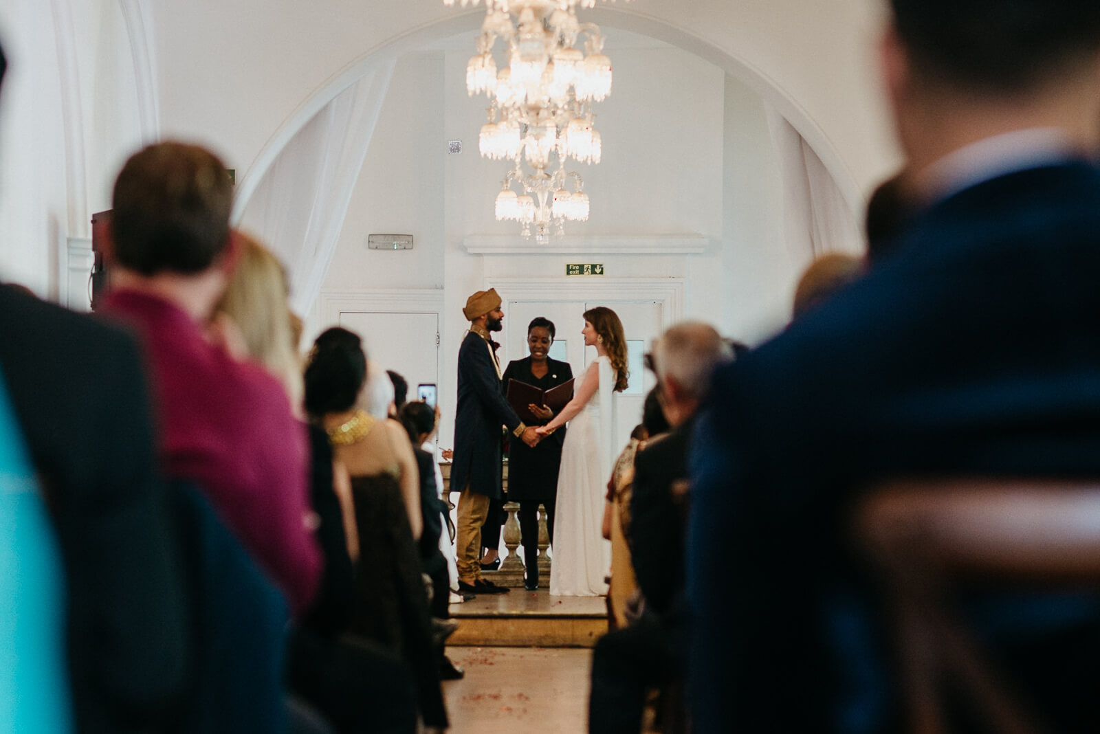 bride and hindu groom exchange vows during their london humanist wedding at Marylebone One