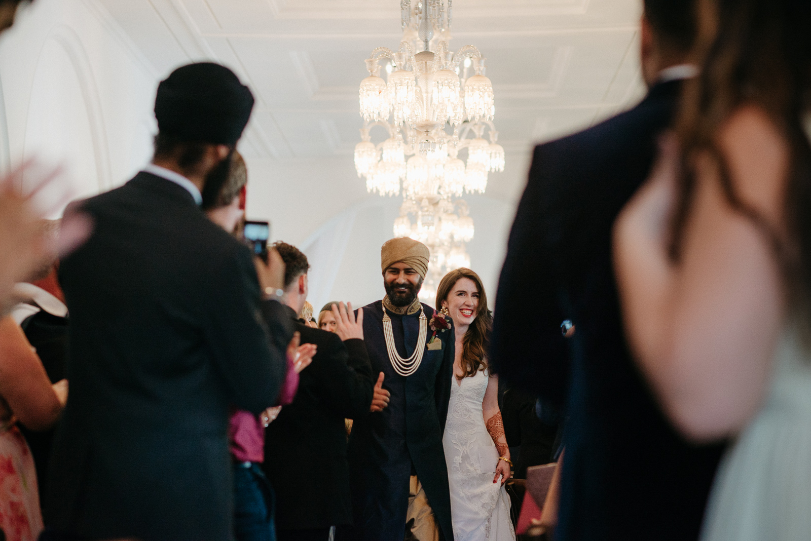 bride and groom are greeted by happy guests following their london wedding ceremony