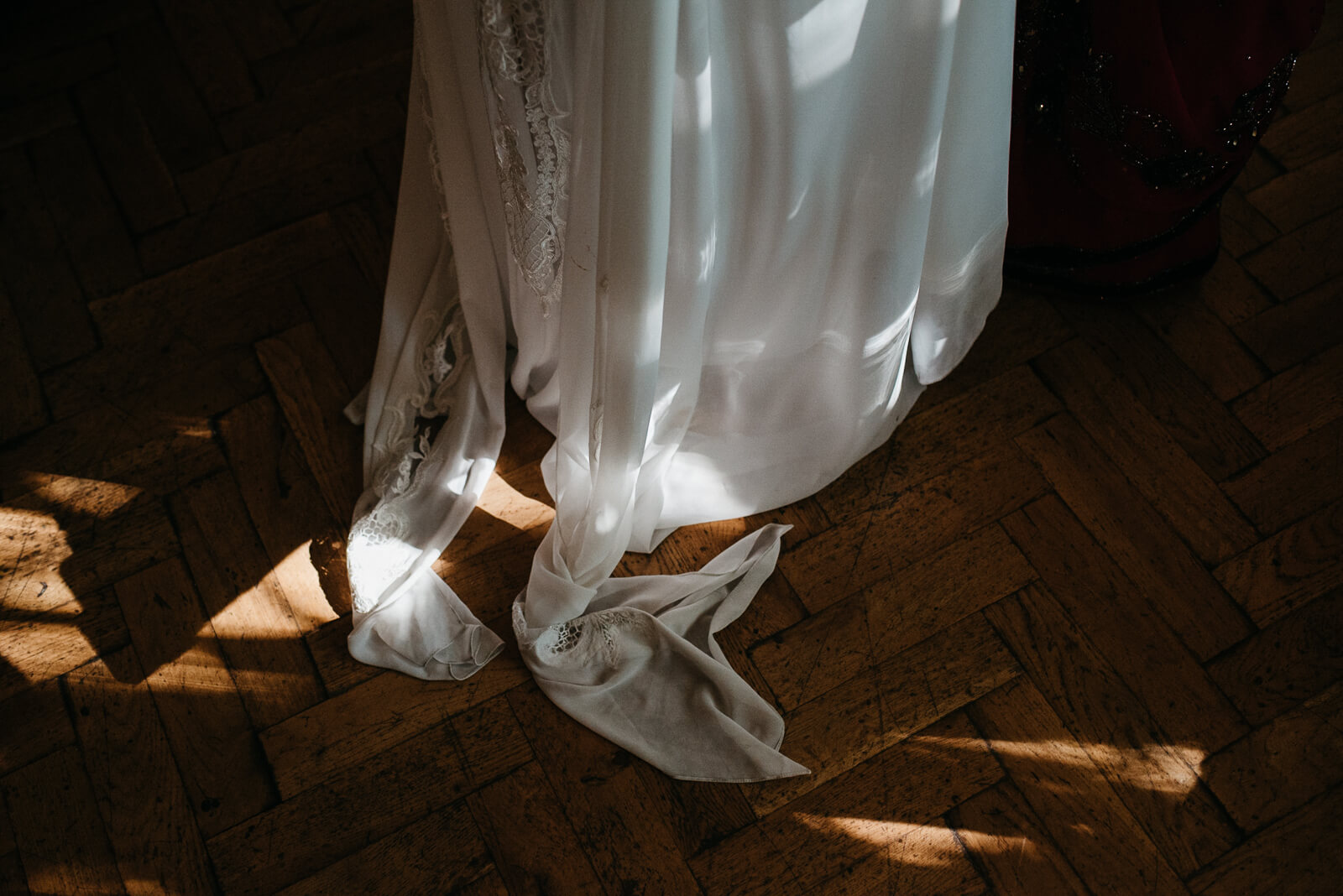 Brides chic stylish dress on parquet flooring at Marylebone One, London