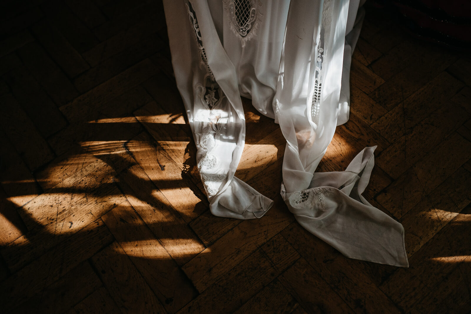 Brides chic stylish dress on parquet flooring at Marylebone One, London