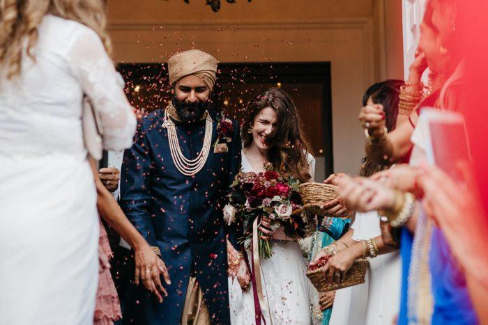 Bride and groom walking through confetti at London wedding venue Marylebone One