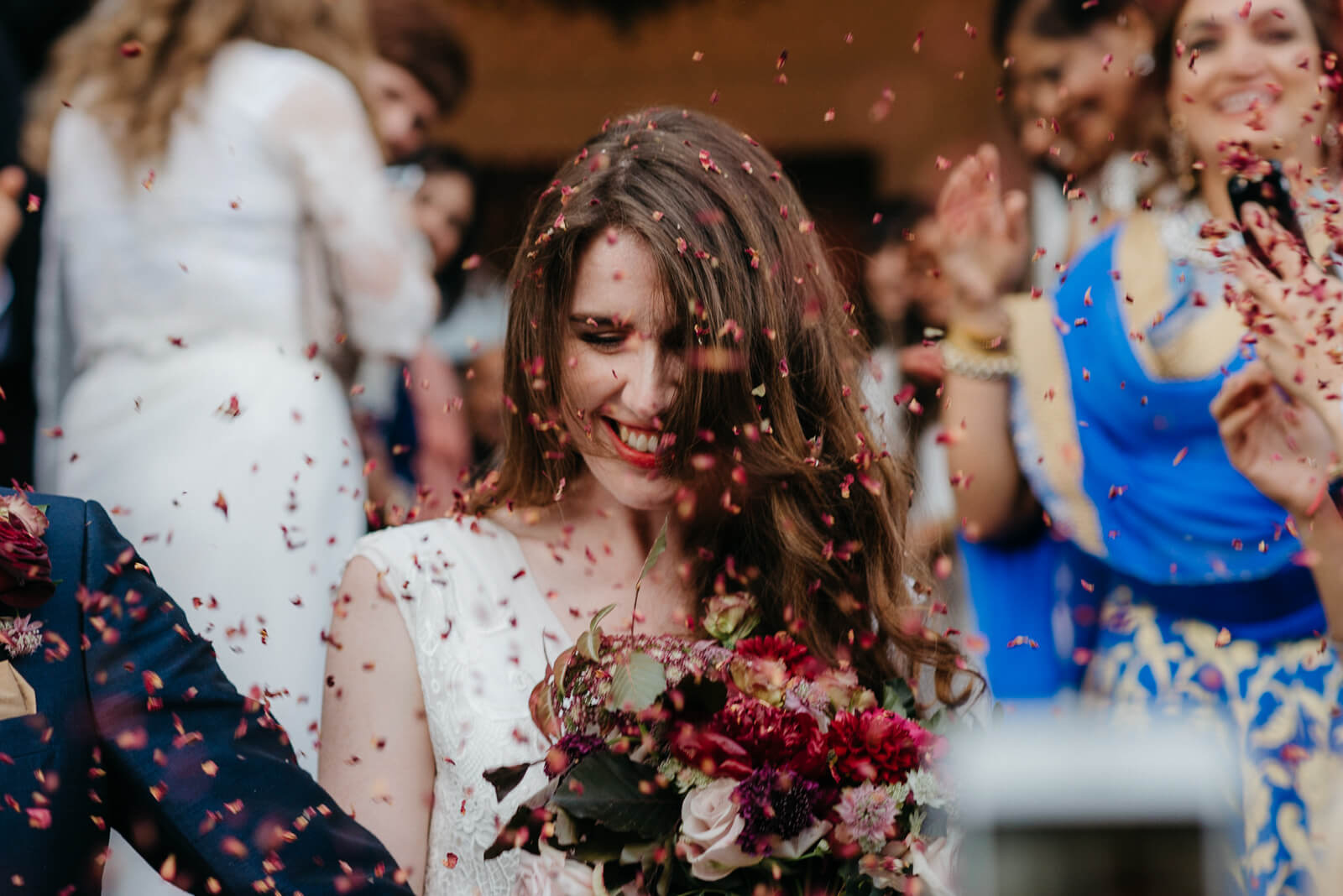 Bride walking through confetti at London wedding venue Marylebone One