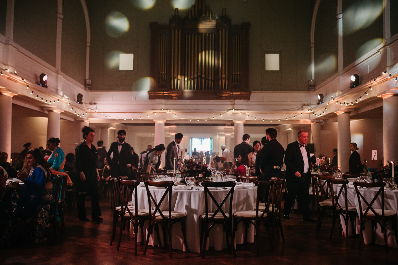 wedding guests arrive in Soane Hall at Marylebone One