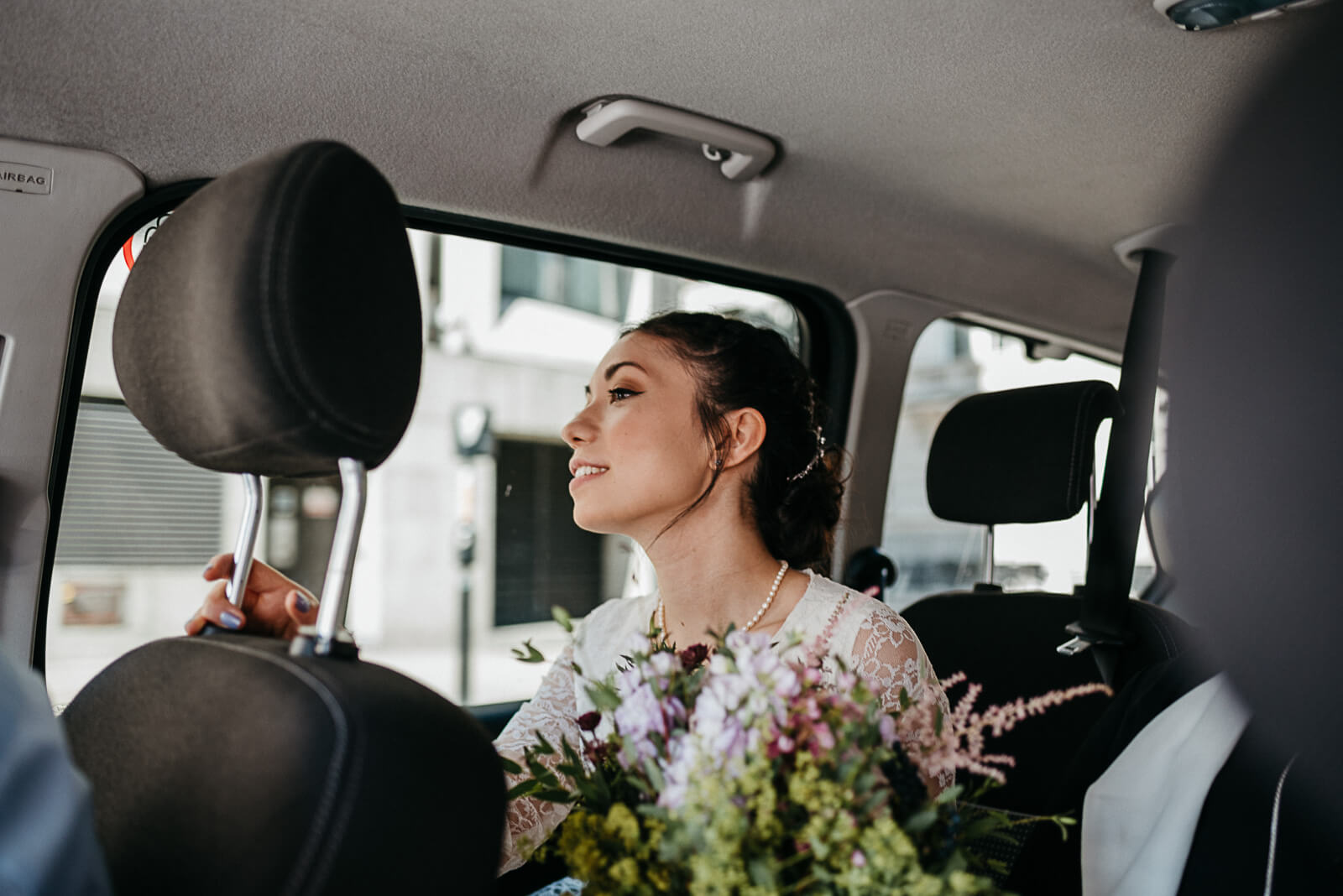 Bride in London cab on way to wedding ceremony at Camden Town Hall