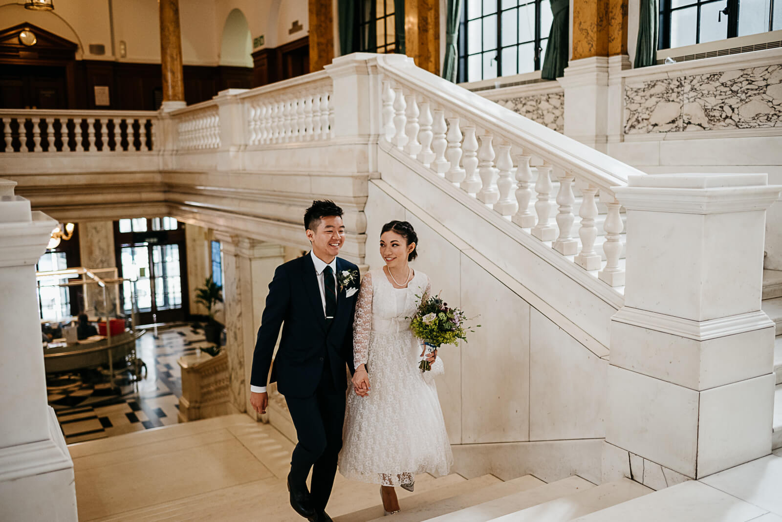 Bride & Groom walking up the stairs at Camden Town Hall
