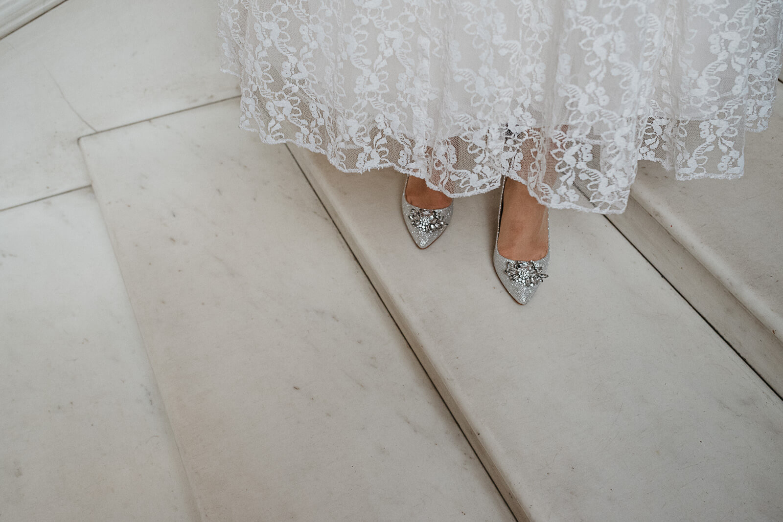 brides sparkly shoes on the marble steps at camden town hall