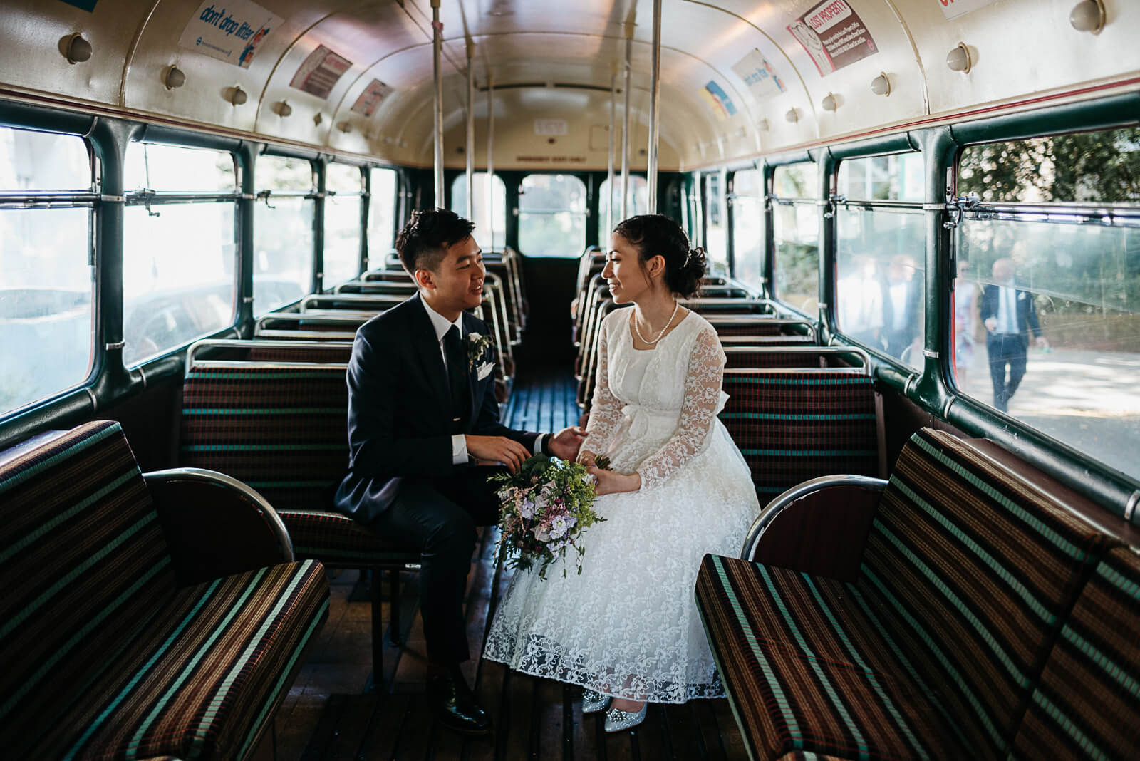Bride & groom on vintage single decker london bus on route to the peasant pub in Islington