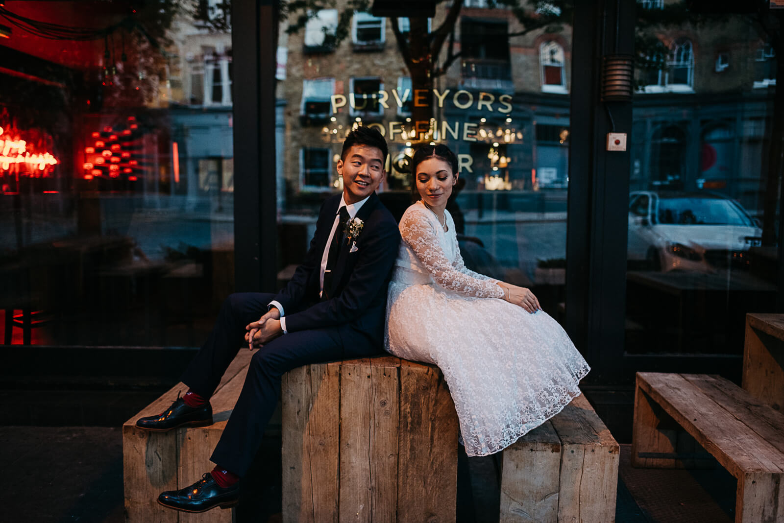 Bride & Groom at dusk outside liquor bar in Islington