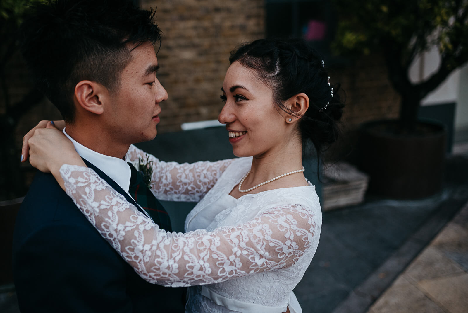 bride and groom share a moment after their Islington wedding