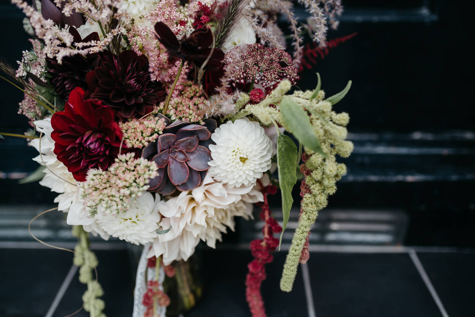 dark, sumptuous bouquet of dark wine and white dahlias, succulents, chocolate cosmos and astilbe