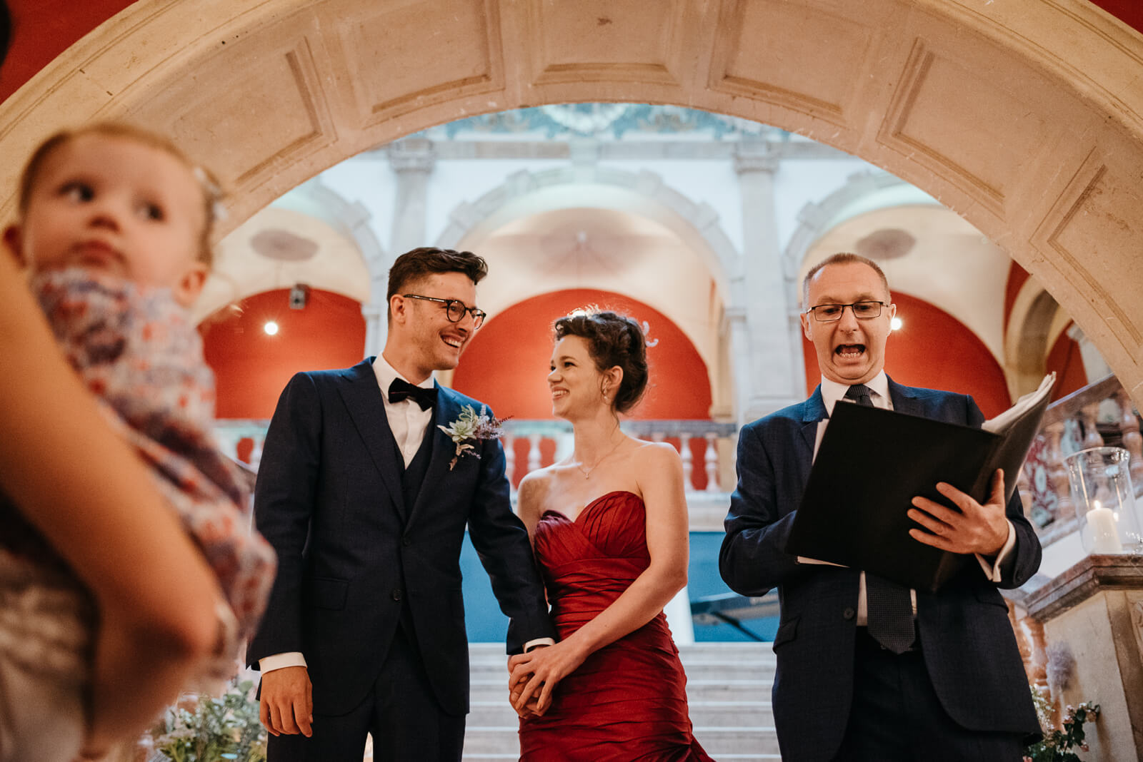 bride and groom share a moment of laughter during their ceremony at Battersea Arts Centre