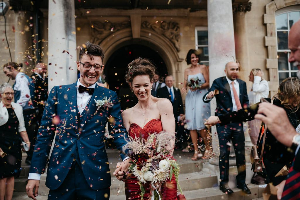 London bride and groom celebrate during confetti throw outside Battersea Arts Centre, Battersea