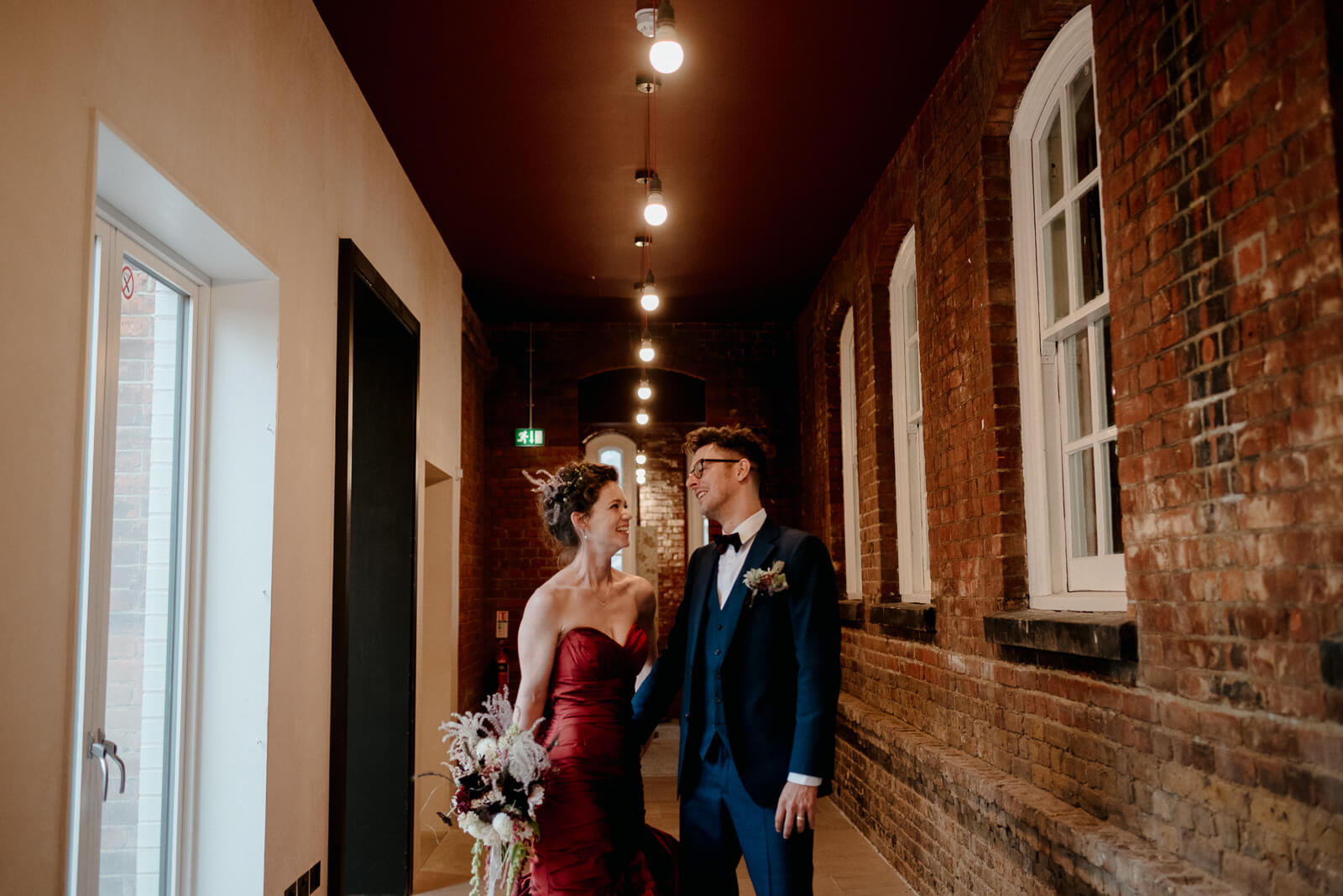 bride and groom laugh during their couple portraits in Battersea Arts Centre