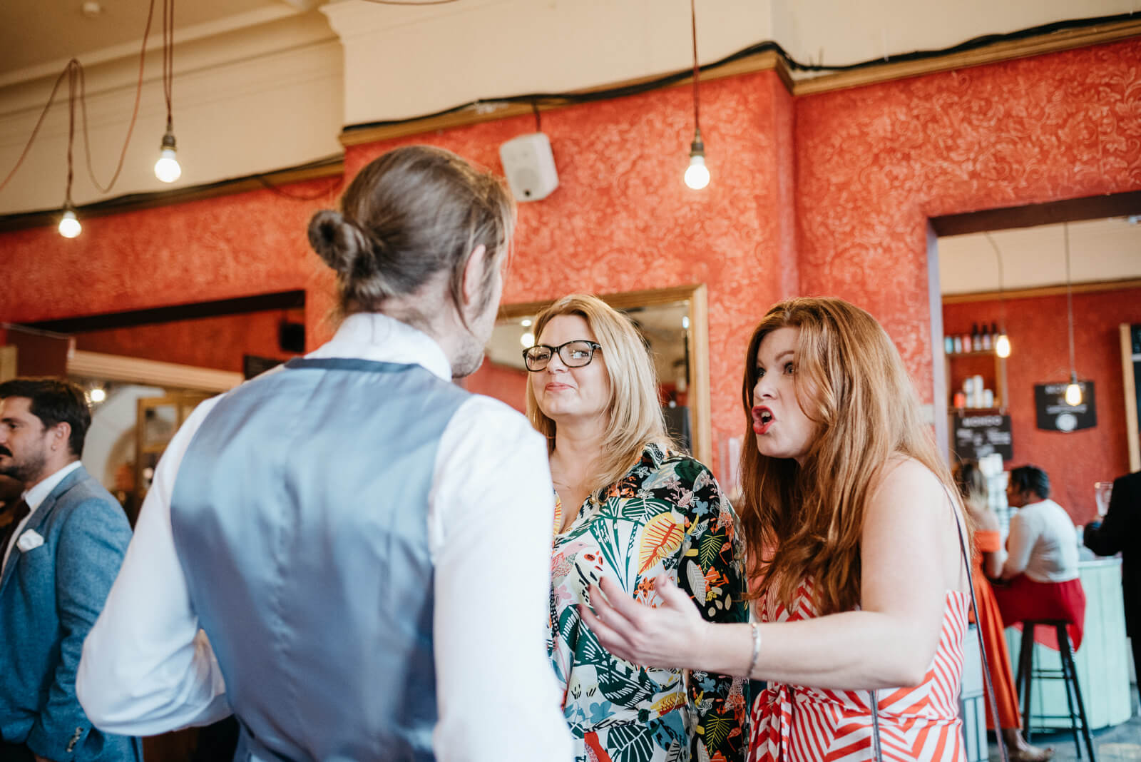 happy guests laugh and joke in bar at Battersea Arts Centre