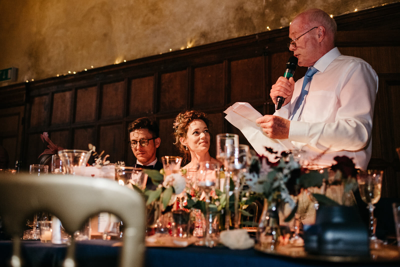 bride proudly watches her dad deliver his speech in Battersea Arts Centres Council Chamber