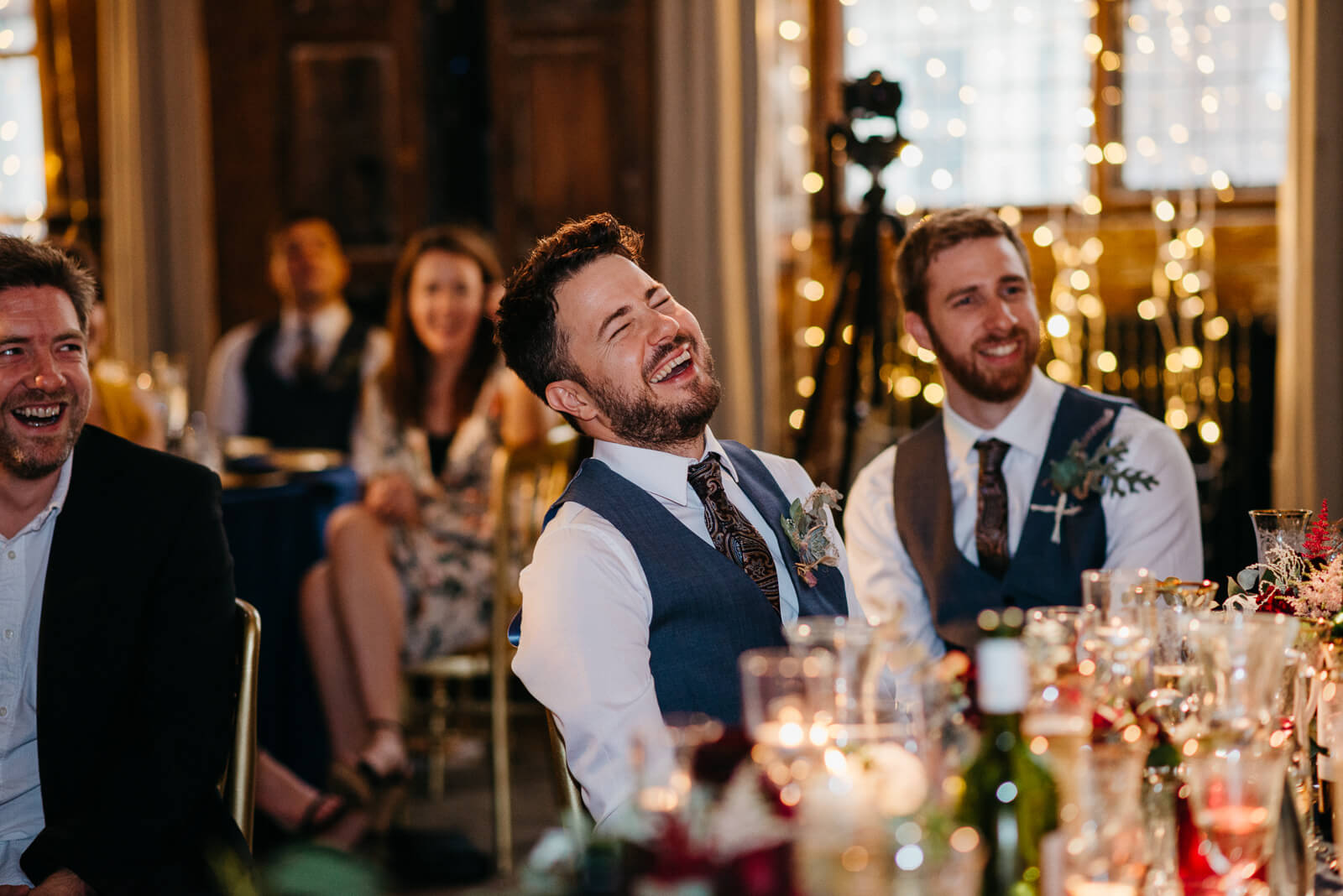 friends laugh during speeches
