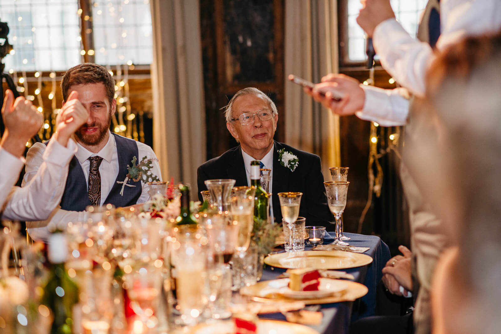 grandad looks on during speeches at London Wedding in Battersea Arts Centre