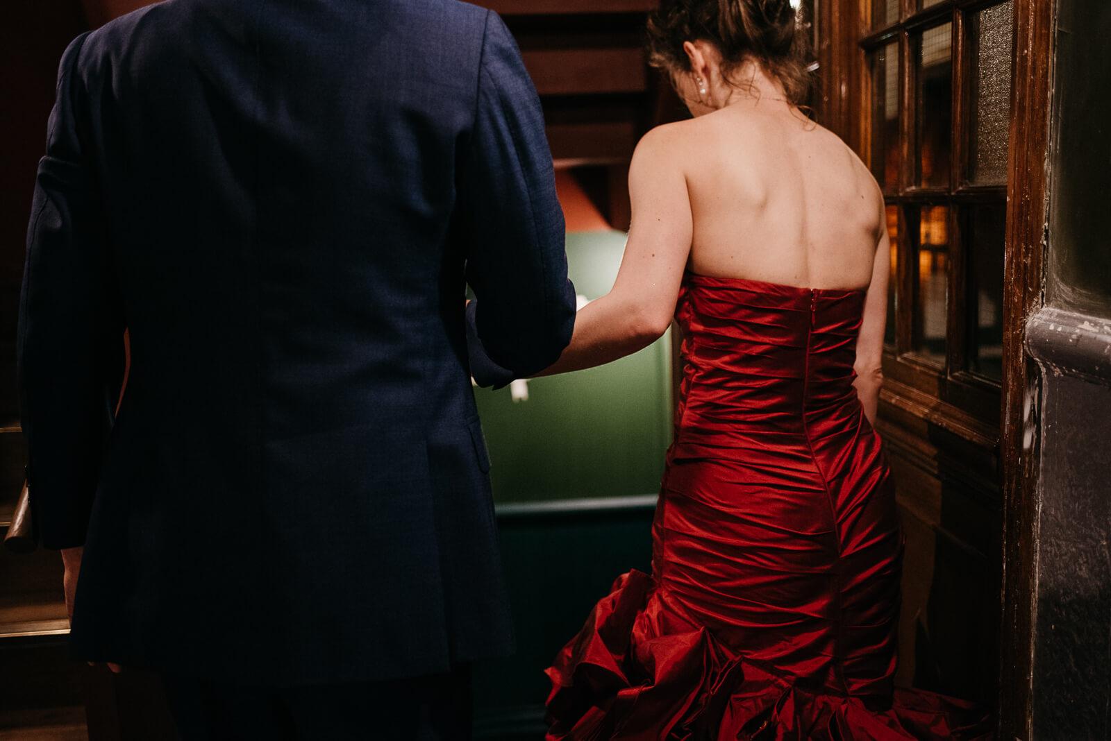 bride and groom sneak away for evening portraits in Battersea Arts Centure