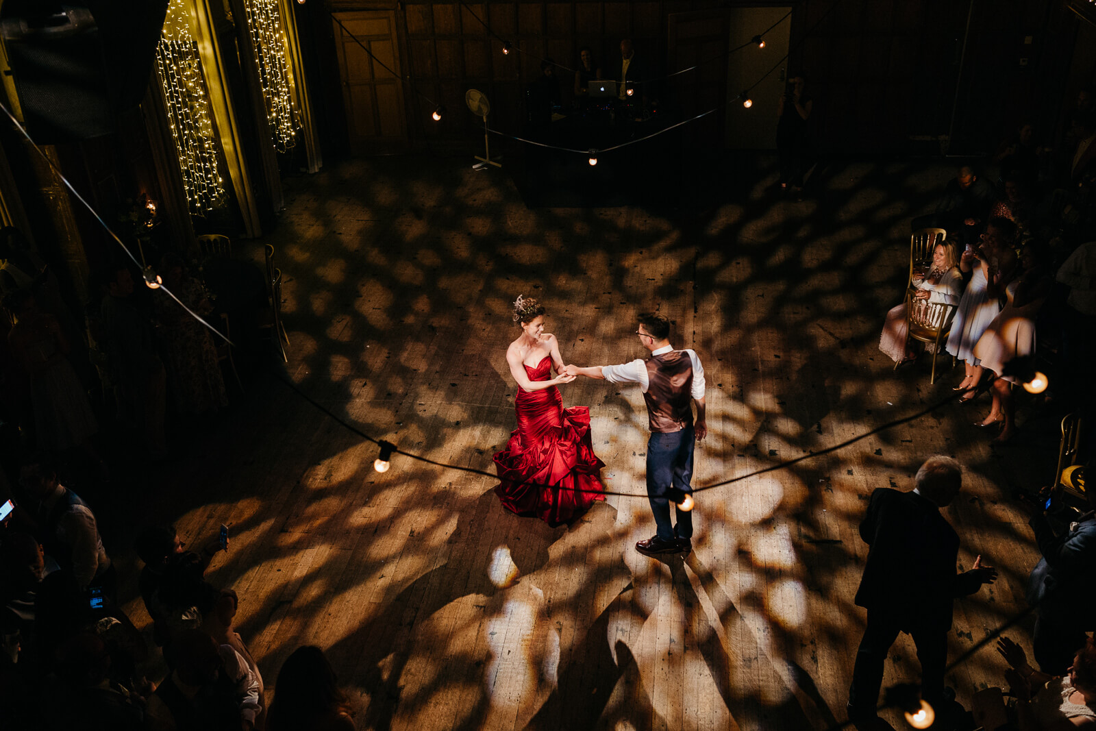 bride and groom dancing under festoons and fairy lights at Battersea Arts Centre