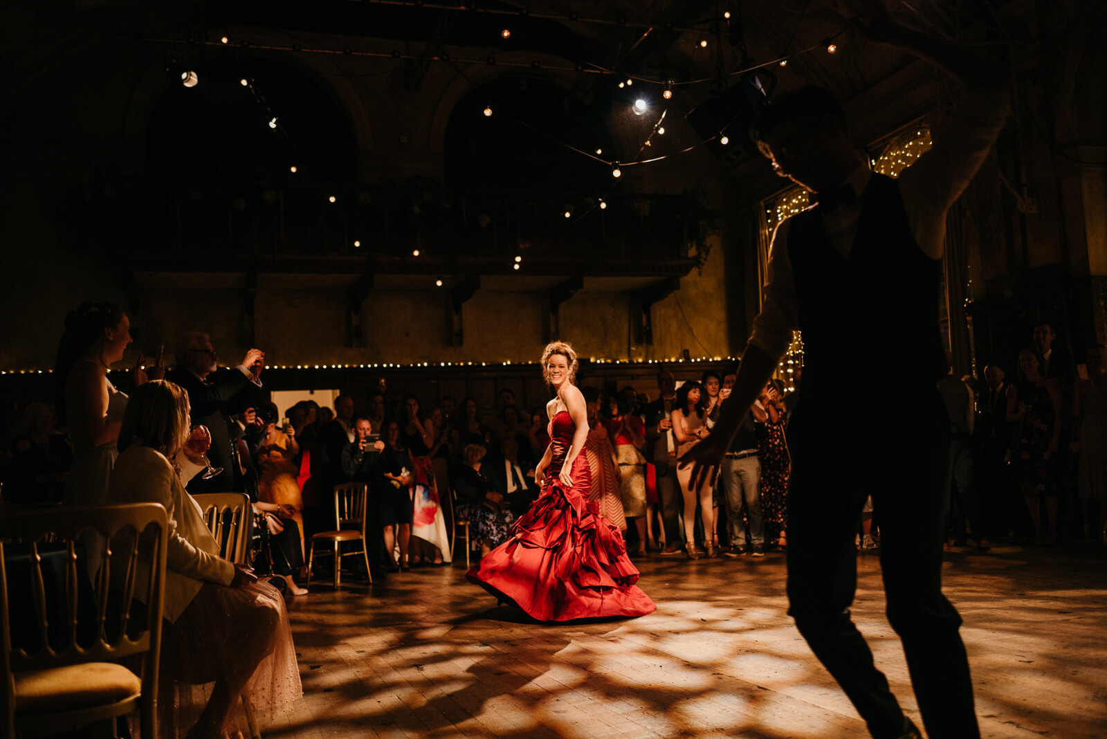 creative reportage photograph of bride dancing at her London wedding