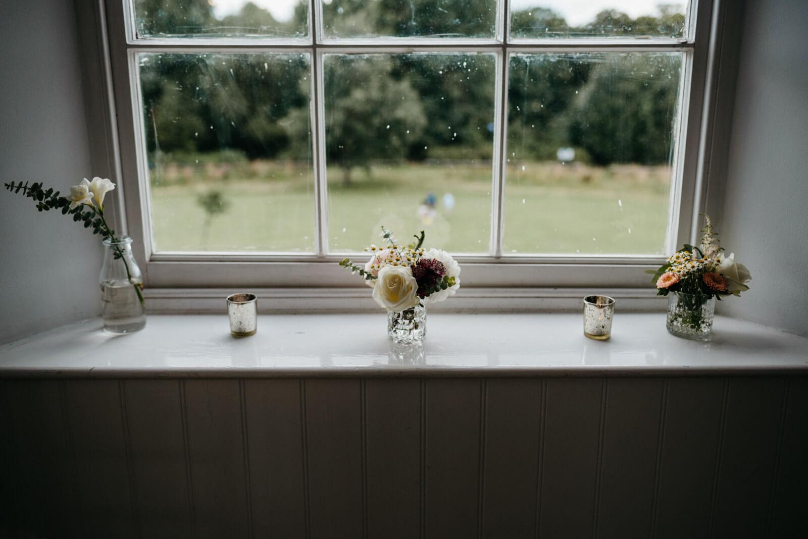 floral arrangements on window ledge looking onto Belair Park