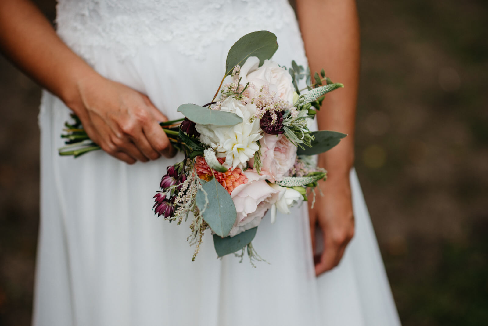 small hand-tied bquet of pale pink, wine and white flowers