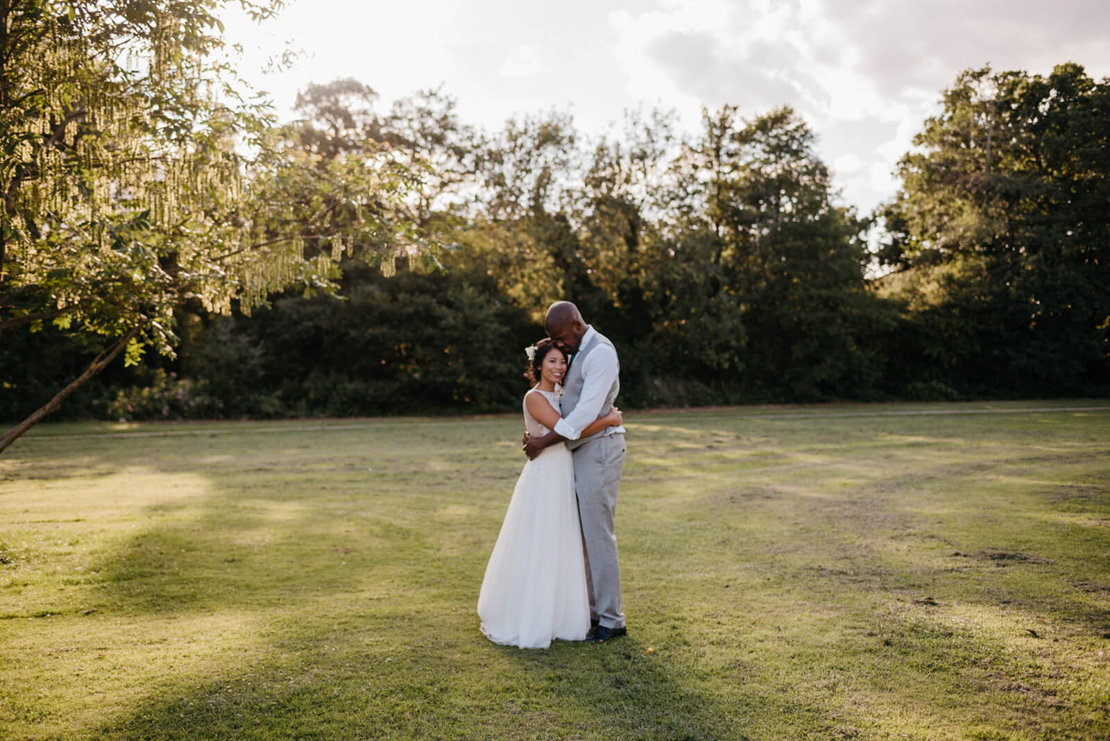 sunset portrait of London couple in Belair Park for their summer wedding
