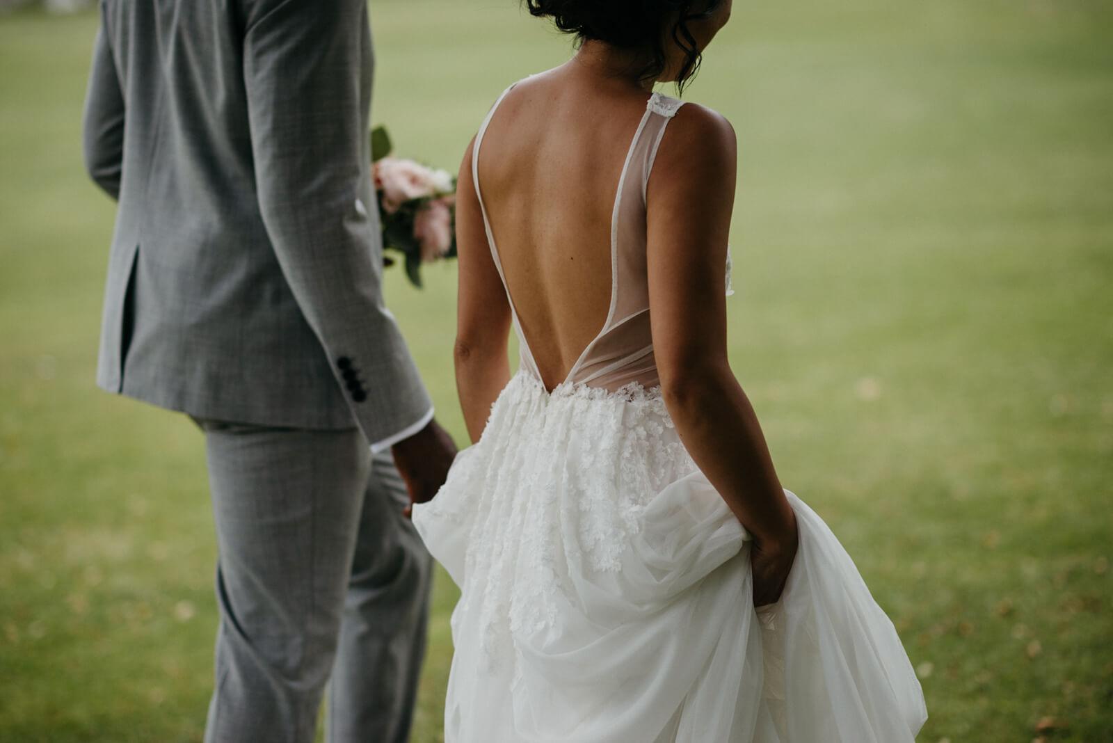 London bride & groom strolling through the park next to Belair House