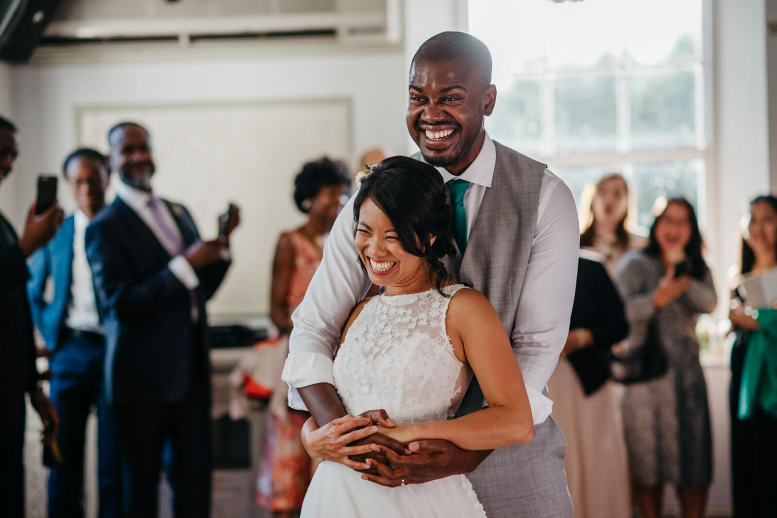 couple laughing during their first dance in the ballroom at Belair House