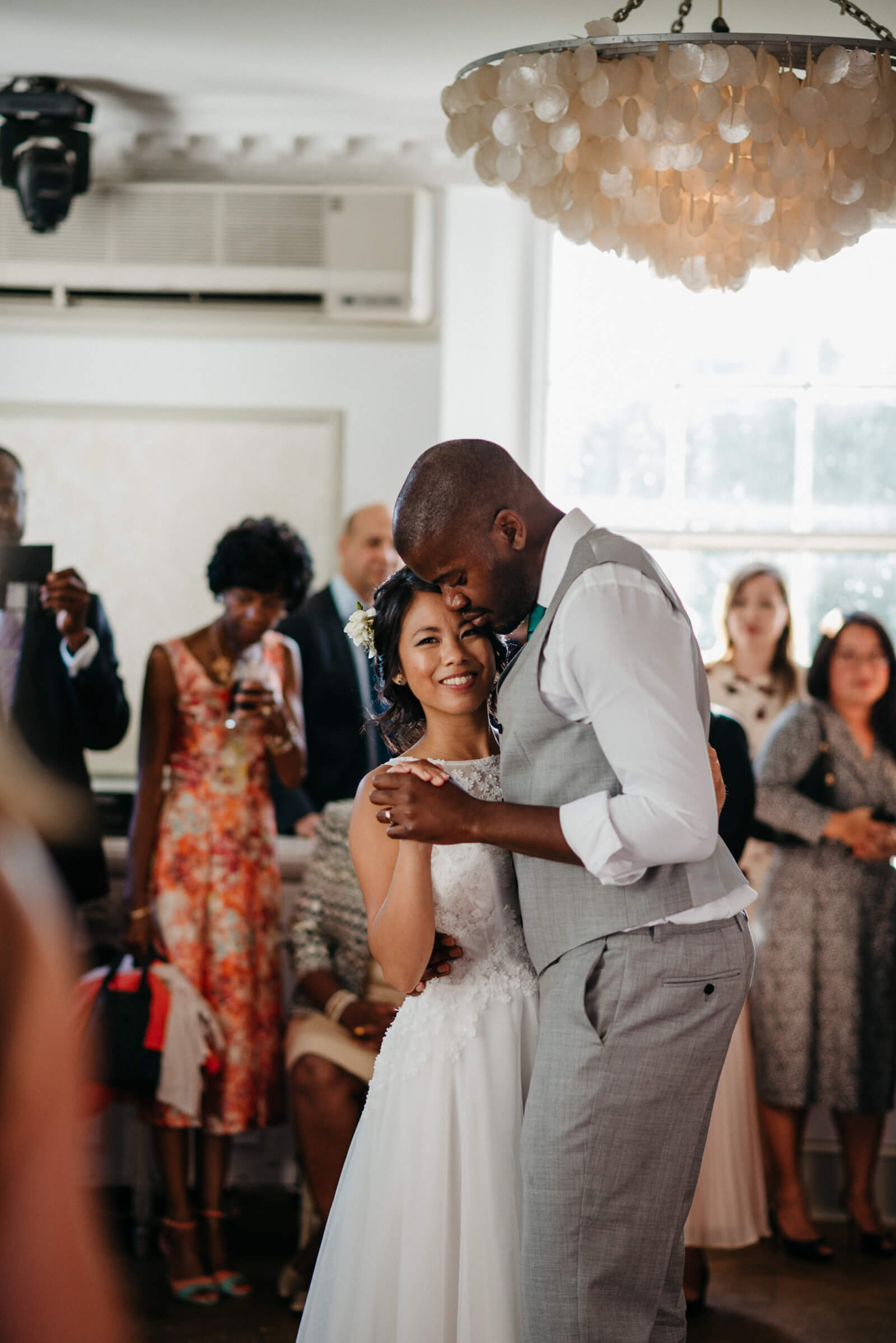 beautiful and natural photograph of bride and groom dancing to their first dance song at Belair House