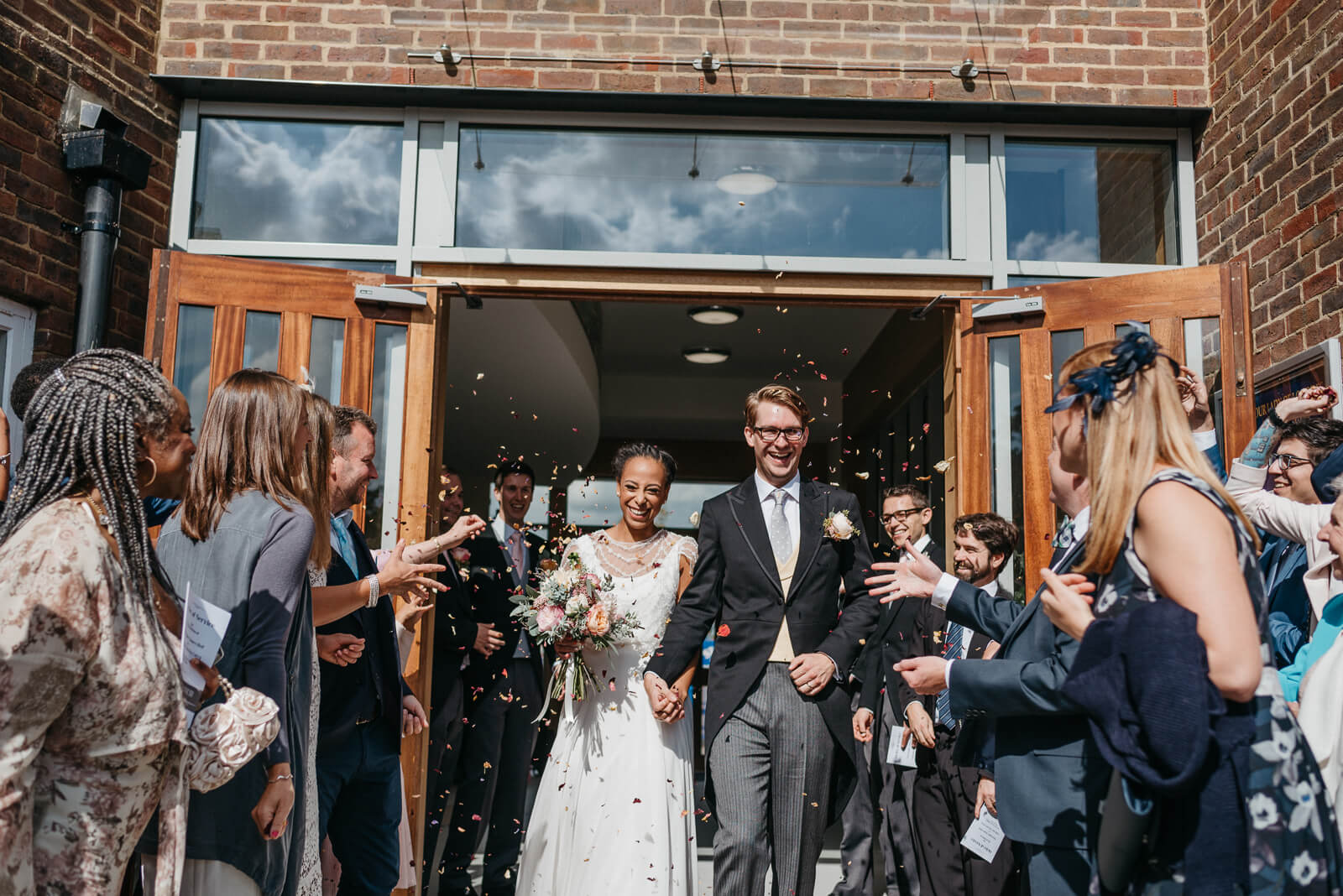 bride and groom celebrate at Our Lady of Lourdes RC Church with confetti