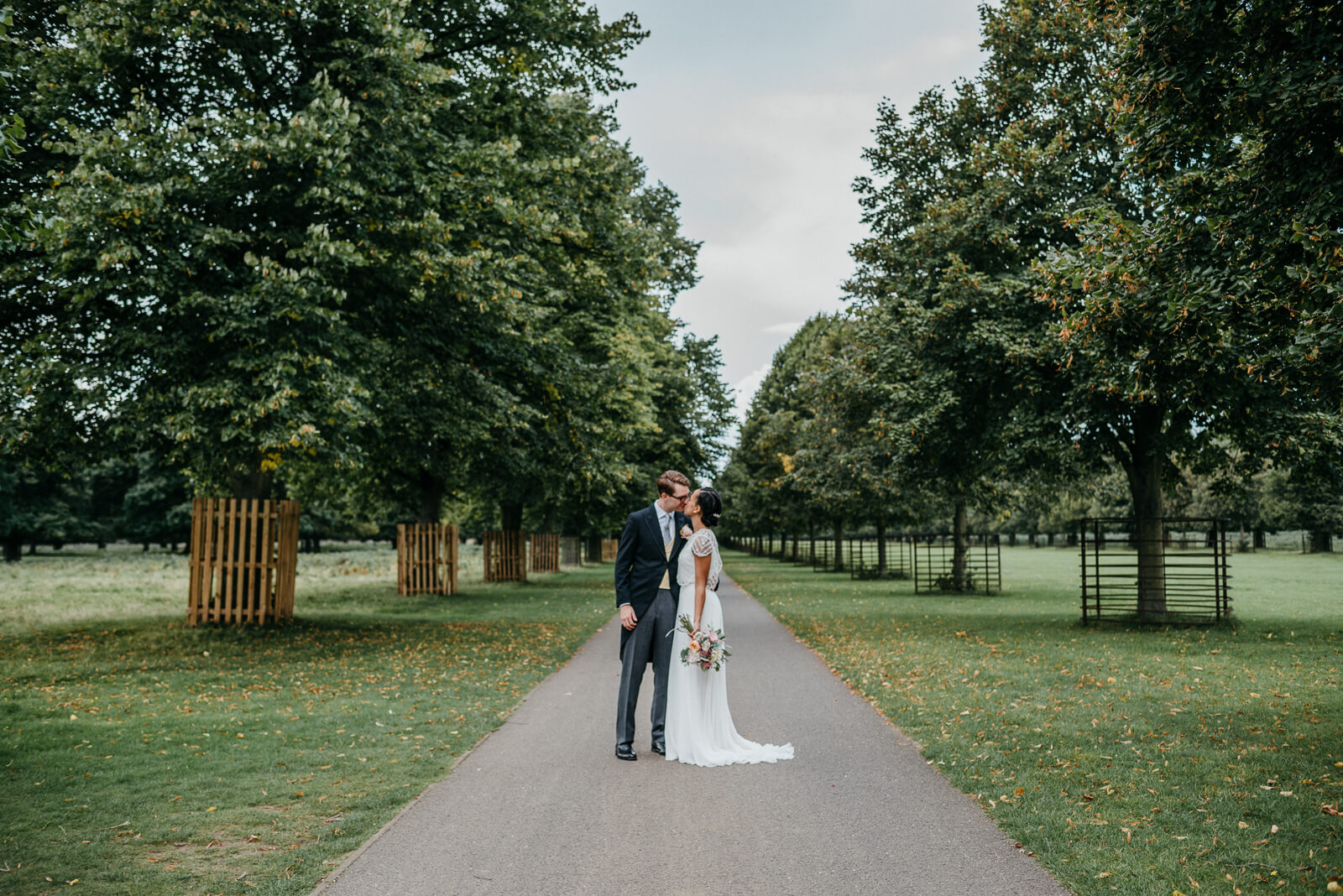 Bride and groom portraits in Bushy Park