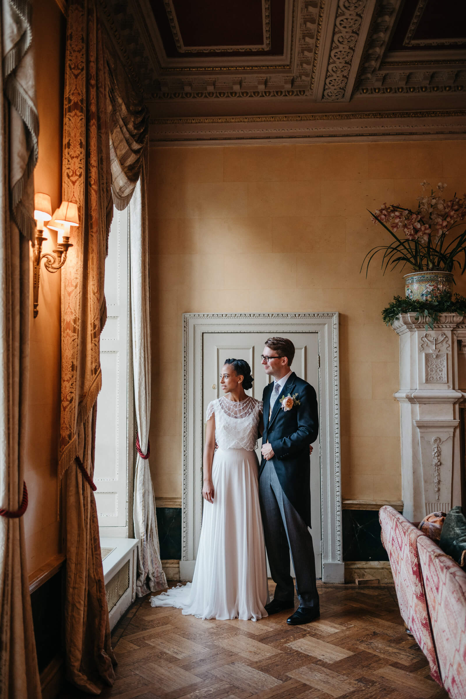 bride and groom portraits inside London wedding venue Hampton Court House