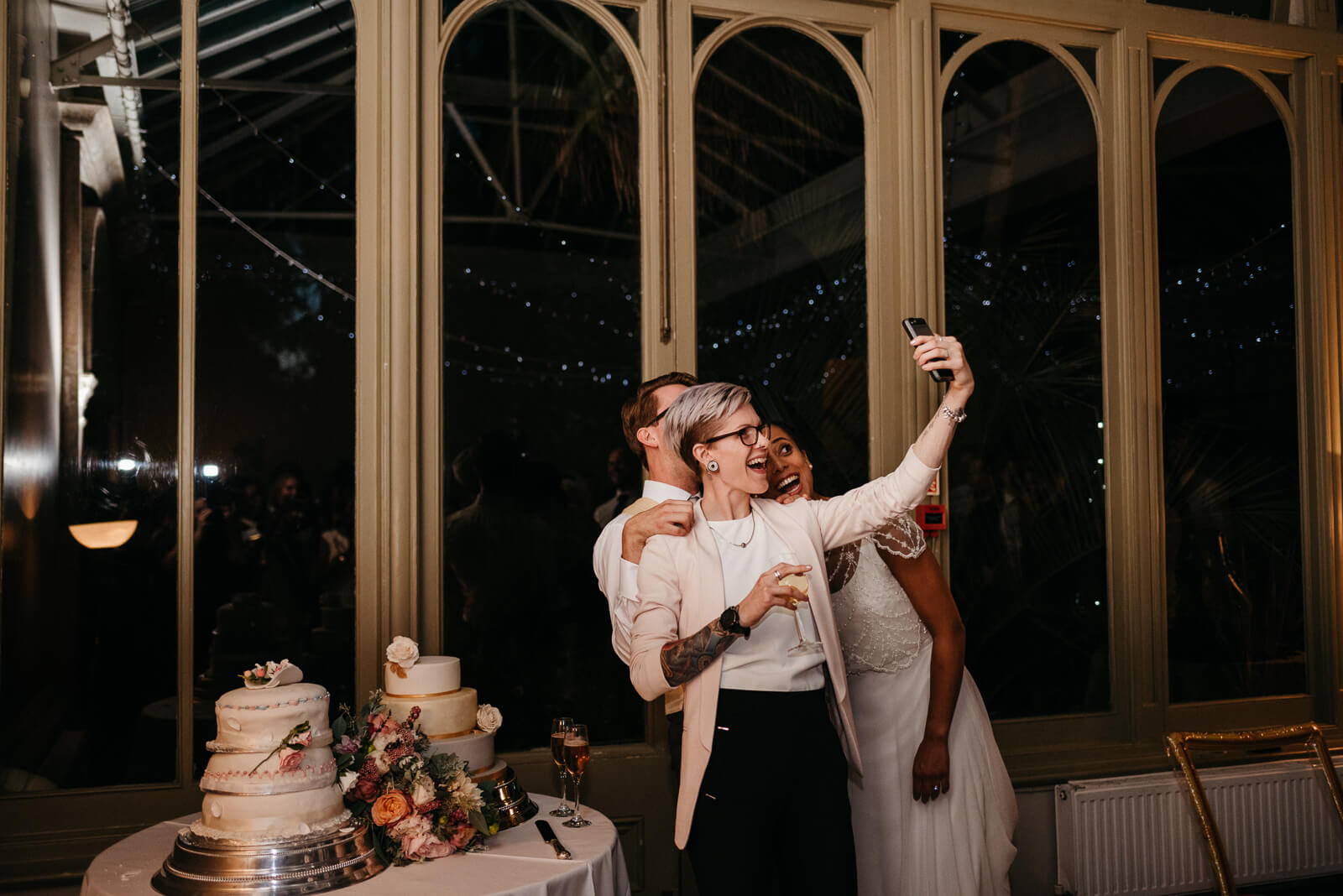 bride and groom take selfies with guests