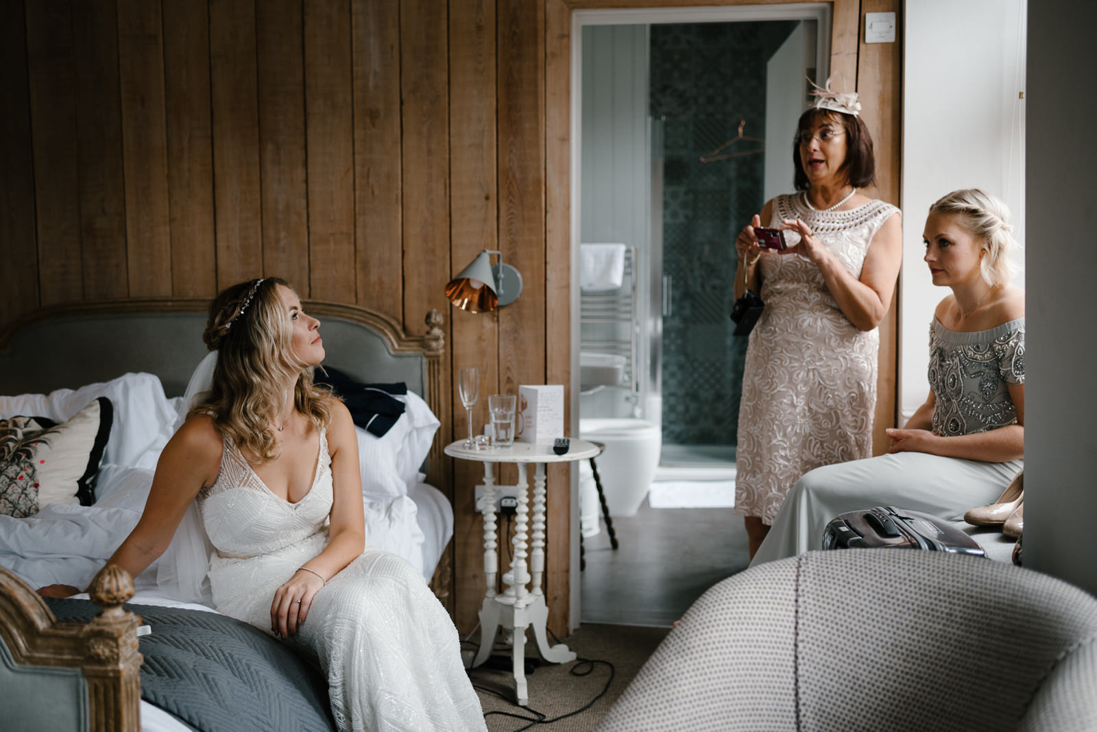 Bride chats with her mum and sister moments before leaving for her Wiltshire Wedding at Glove Factory Studios