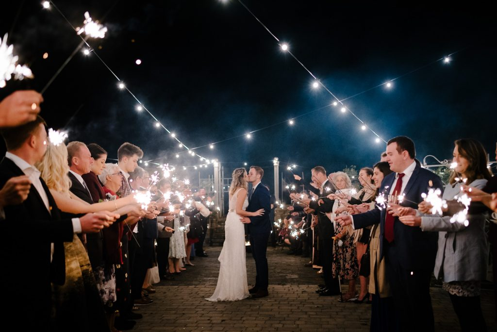 Relaxed Bride & Groom dance under festoon lighting at their Glove Factory Studio Wedding