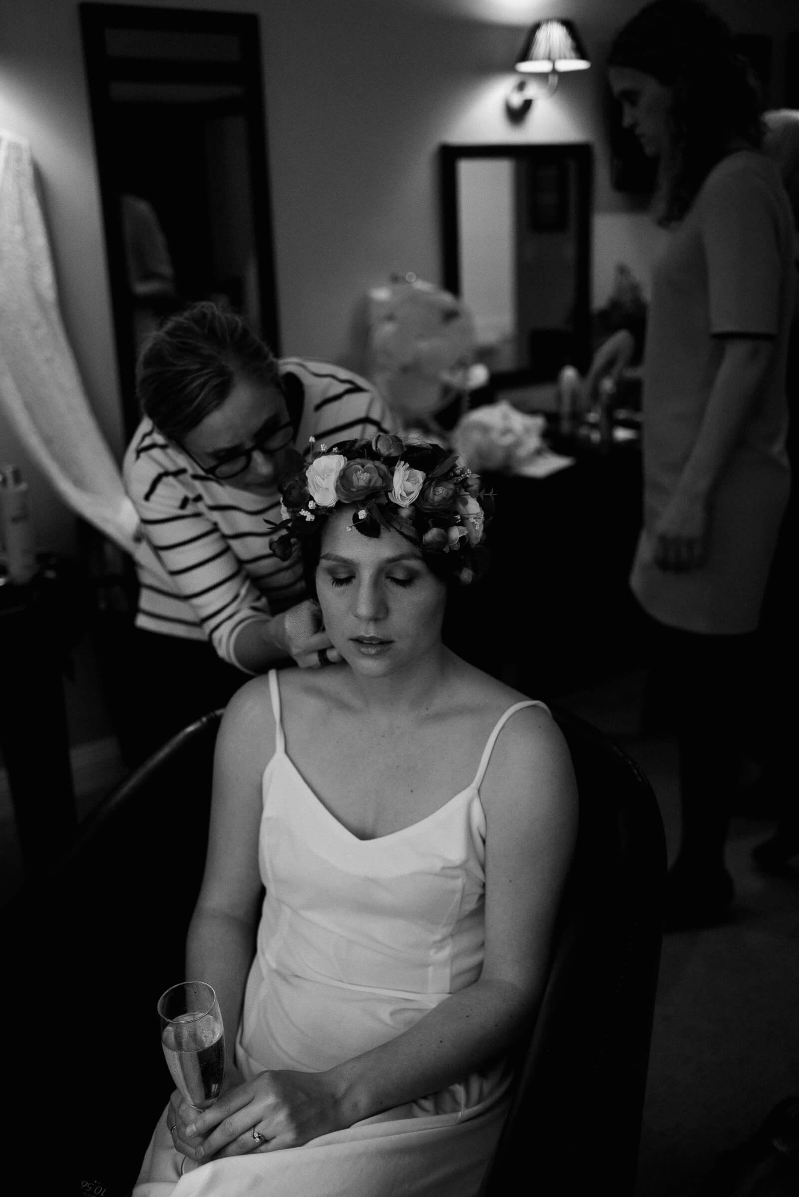 black and white portrait of bride getting ready for her woodland wedding