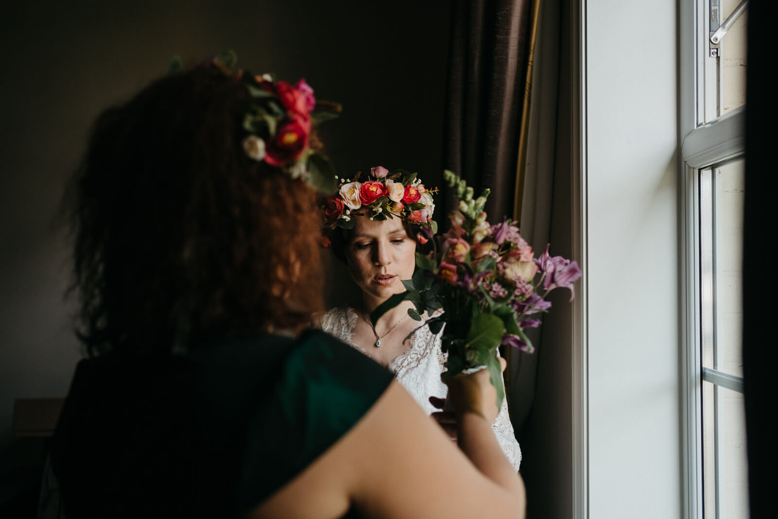 boho bride getting ready at Lyndhurst, Hampshire hotel before her woodland wedding