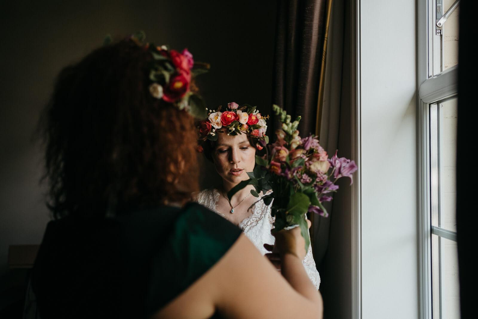 boho bride getting ready at Lyndhurst, Hampshire hotel before her woodland wedding