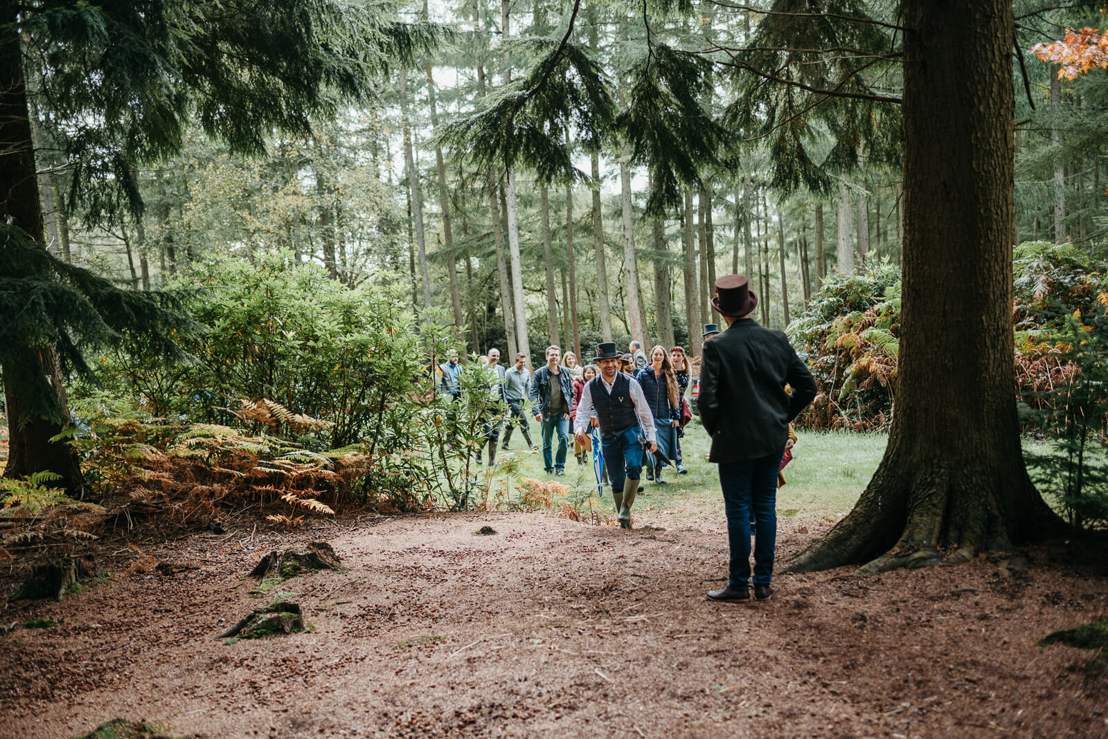 guests arriving for a woodland wedding in England