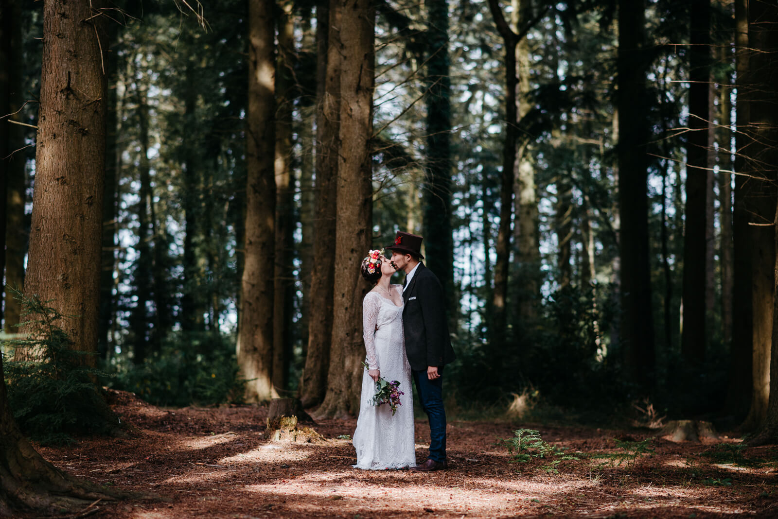 Couple portrait after their autumn woodland wedding in the New Forest, Hampshire