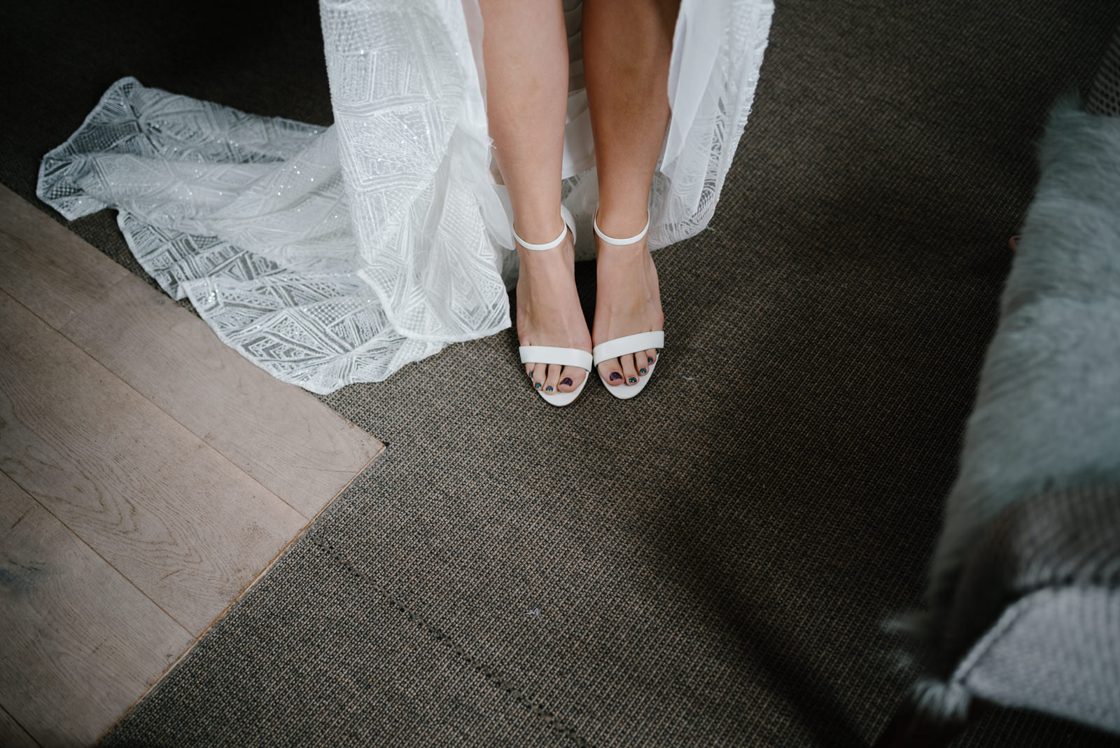 bride standing in her wedding shoes before leaving Timbrell's yard in Bradford on Avon