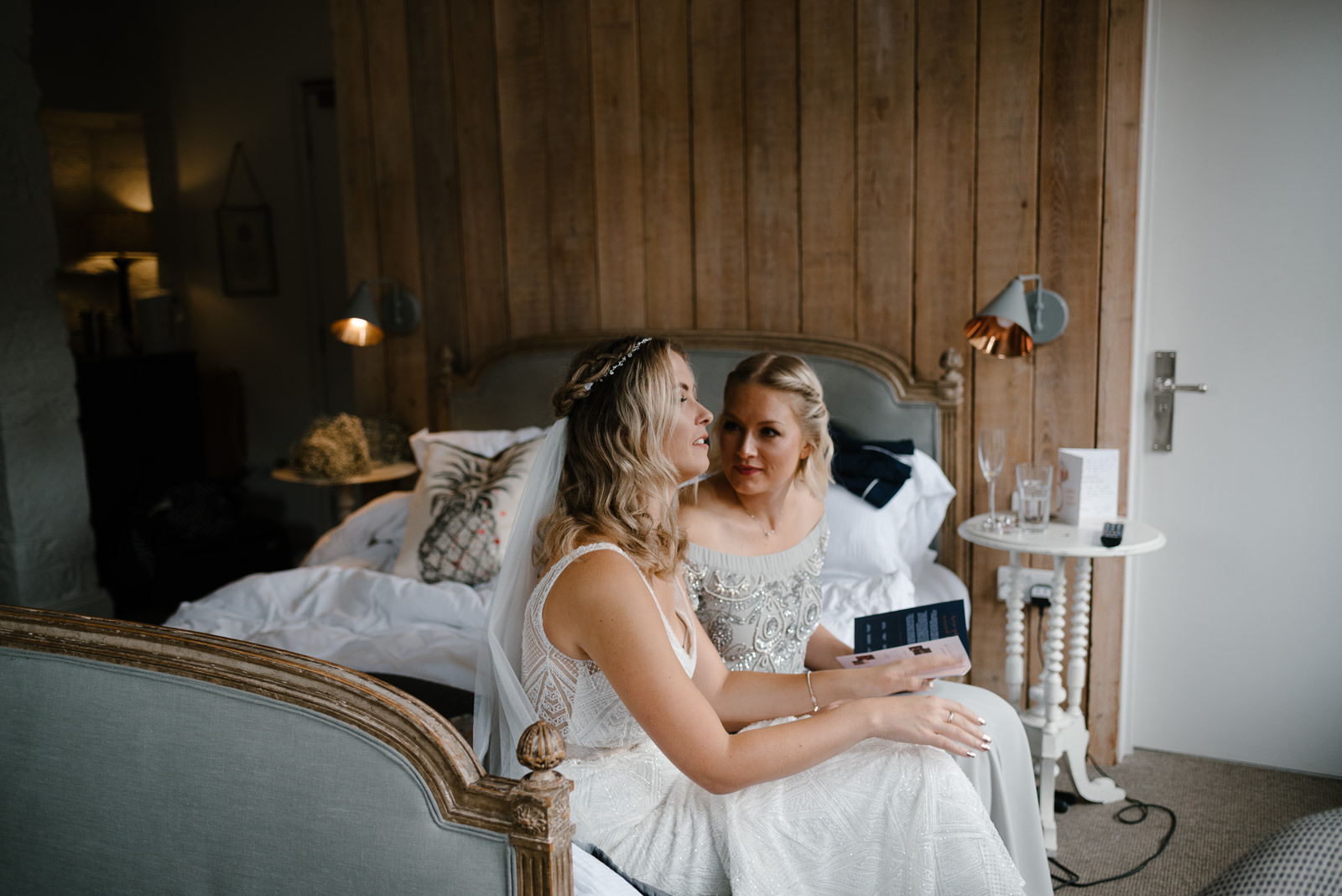 bride chats with her bridesmaid at Timbrell's Yard in Bradford on Avon