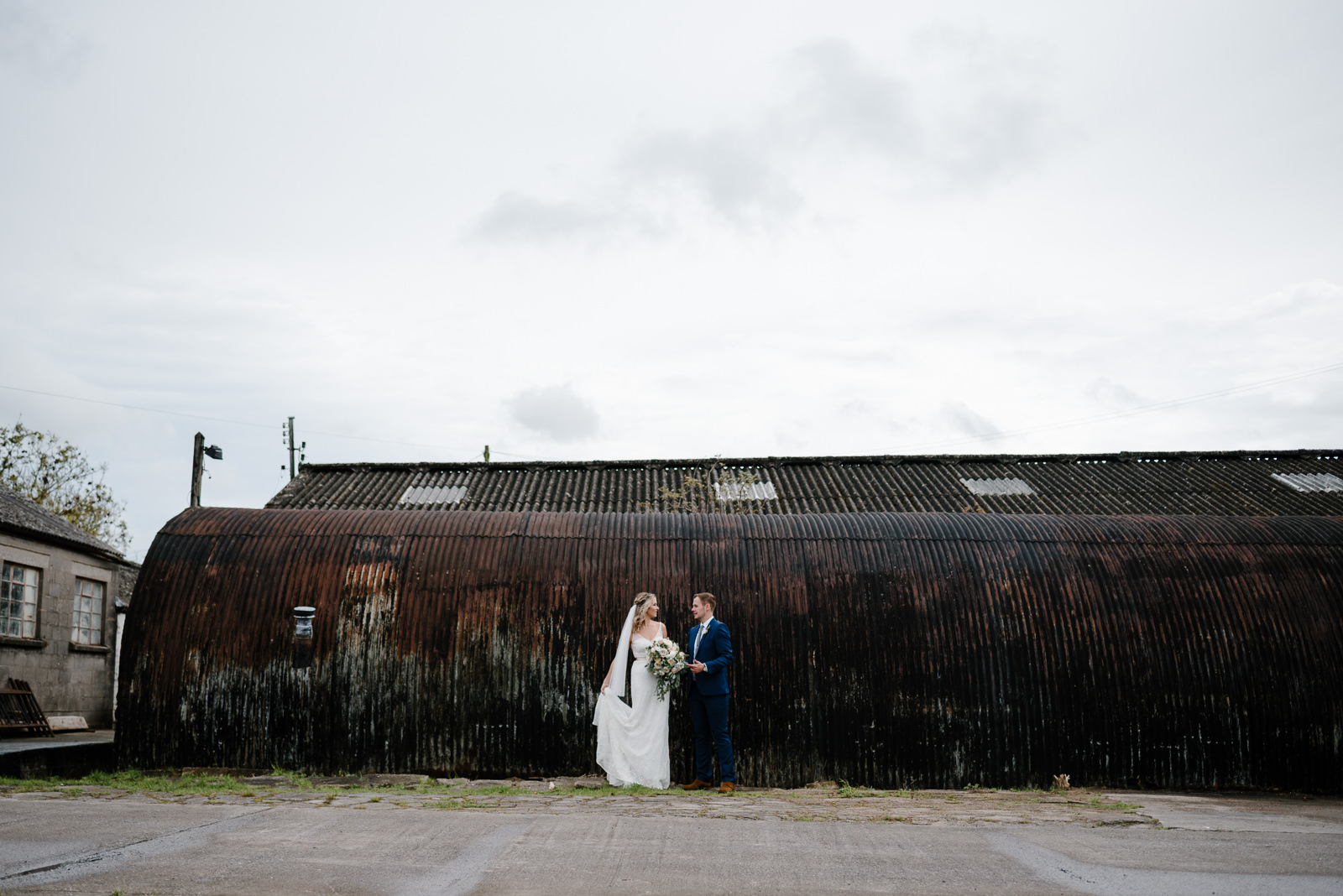 modern bride and groom portraits in industrial setting