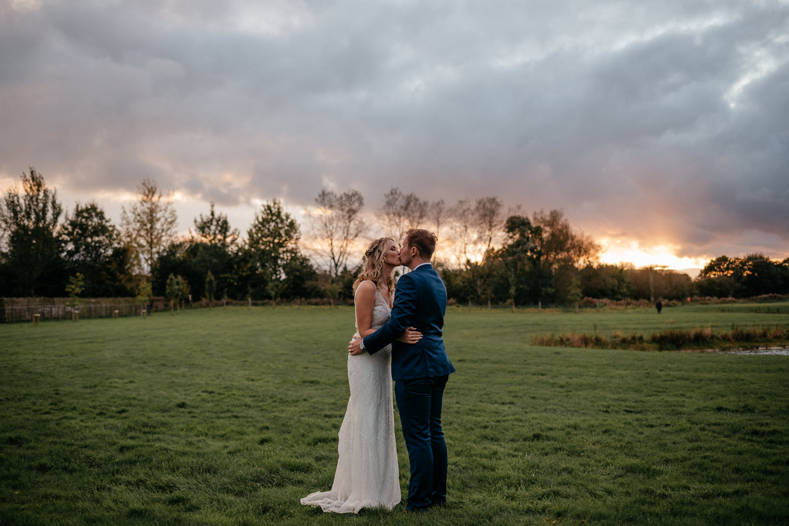 Wiltshire bride and groom take a break for sunset portraits at Glove Factory