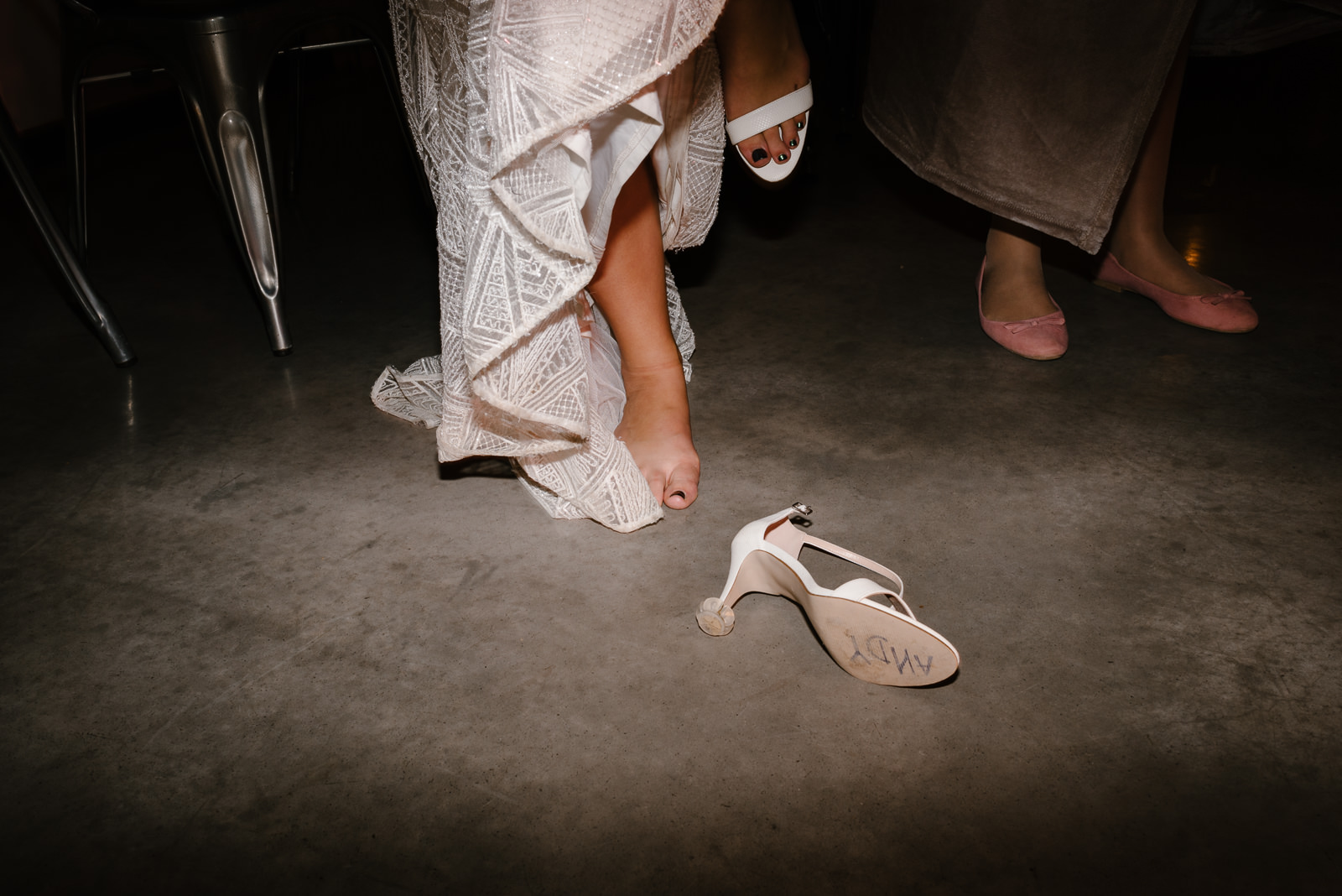 bride kicking her shoes off to dance at her wiltshire wedding